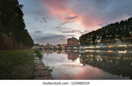 Vatican City, Rome, Italy, Beautiful Vibrant Night image Panorama of St. Peter's Basilica, Ponte St. Angelo and Tiber River at Dusk in Summer. Reflection of The Papal Basilica of St. Peter