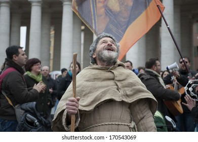 Vatican City, Rome, Italy - March 17, 2013: Man sings surrounded by pilgrims in St. Peter's Square.