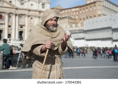 Vatican City, Rome, Italy - March 17, 2013: Man talks with faithful in St. Peter's Square.