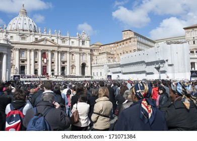 Vatican City, Rome, Italy - March 19, 2013: Pilgrims listen and pray to the mass of Pope Francis in St. Peter's Square.