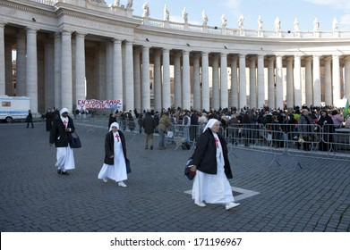 Vatican City, Rome, Italy - March 19, 2013: Sisters walk in Saint Petet's square during the hearing of Pope Francis.