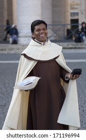 Vatican City, Rome, Italy - March 19, 2013: Monk listen at the hearing of Pope Francesco in St. Peter's Square.