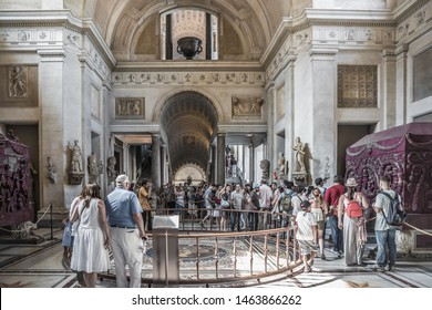Vatican City, Rome - July 13th 2015: Crowd of tourists visiting the Vatican Museums. People sightseeing to experience historical artefacts and famous art works