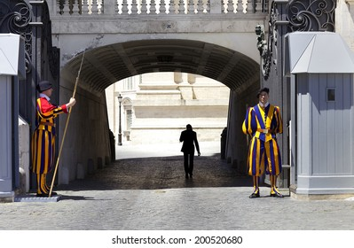 VATICAN CITY, ROME - JUNE 3, 2014: Swiss Guard standing guard with a halberd on June 3, 2014 in Vatican City. Vatican City State is a sovereign city-state within the city of Rome