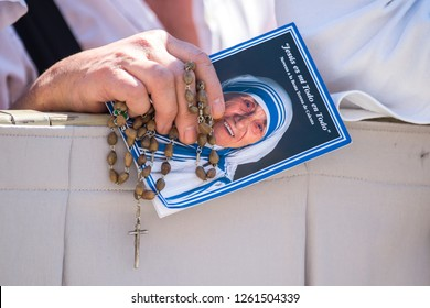 Vatican City, September 03, 2016: A woman holds a pictures of Saint Mother Teresa and a Rosary.