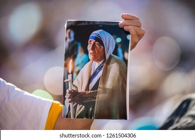 Vatican City, September 04, 2016: A woman holds a picture of Saint Mother Teresa of Cacuta
