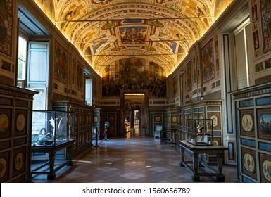 Vatican City - September 17 2019: Interiors of Vatican museum. No people in the halls of Museum of Vatican. Beautiful paintings and sculptures in Vatican museum with no people around.