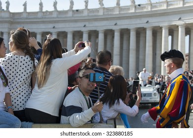 Vatican City, Vatican city State - April 1, 2015: Pope Francis bless faithful in St. Peter's square during general audience