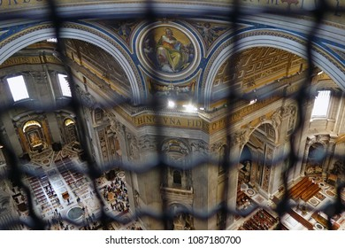 VATICAN CITY, VATICAN STATE -  APRIL 10, 2018: aerial view of Saint Peter Basilica  interior, low angle shot from the dome