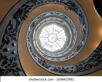 Vatican City State - October 29, 2019 : View looking up at the octagonal skylight above the Bramante Staircase in Vatican Museums (Musei Vaticani). It was designed by Giuseppe Momo in 1932.