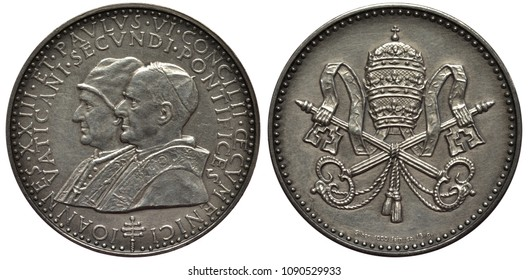 Vatican City token depicting pope Ioannes XXIII and pope Paulus VI , conjoined busts left, papal arms, tiara above crossed keys twinned with ribbon and rope,
