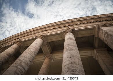 VATICAN CITY,ITALY-MARCH 22,2012: Columns of Apostolic palace, Palazzo Apostolico, square, Piazza San Pietro, Vatican city, Rome, Italy.