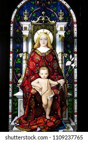 VATICAN, ITALY -APRIL 11, 2010: Beautiful stained glass depicting Madonna and the Child Jesus