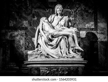 """Vatican, Italy - December 9, 2018: La Pieta (""""The Pity"""") 1499 Renaissance sculpture by Michelangelo Buonarroti, inside St. Peter's Basilica in black and white with vignetting effect, spotlight effect."""