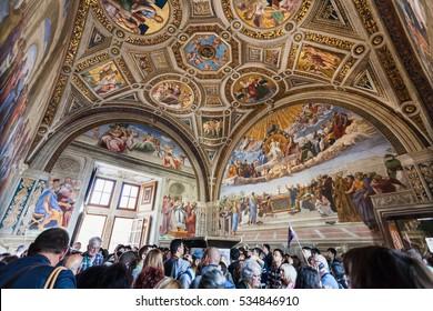 VATICAN, ITALY - NOVEMBER 2, 2016: Visitors in Stanza della segnatura (Room of the Signatura) decorated by Raphael's frescoes in Raphael Rooms (Stanze di Raffaello) of Vatican museums.