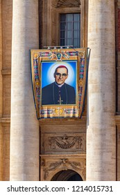 Vatican / Italy - October 14, 2018. Saint Peter's Square. Tapestry with the image of Archbishop Oscar Romero hanging from a balcony of the facade of St. Peter's Basilica during the canonisation mass