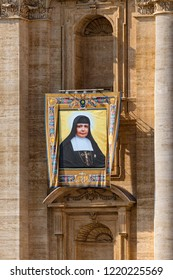 Vatican / Italy - October 14, 2018. Saint Peter's Square. Tapestry with the image of Nazaria Ignacia March Mesa hanging from a niche of the facade of St. Peter's Basilica during the canonisation mass