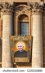 Vatican / Italy - October 14, 2018. Saint Peter's Square. Tapestry with the image of Father Francesco Spinelli hanging from a balcony of the facade of St. Peter's Basilica during the canonisation mass