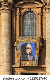 Vatican / Italy - October 14, 2018. Saint Peter's Square. Tapestry with the image of Mother Catherine Kasper hanging from a balcony of the facade of St. Peter's Basilica during the canonisation mass