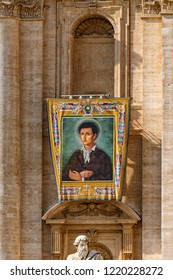 Vatican / Italy - October 14, 2018. Saint Peter's Square. Tapestry with the image of Nunzio Sulprizio hanging from a niche of the facade of St. Peter's Basilica during the canonisation mass