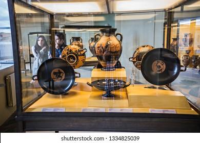 VATICAN - June 2018: Collection of ancient vases, Corinthian, Laconian, Attic  Greek ceramic vases with black figures, Gregorian Etruscan Museum, Vatican, Rome