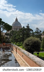 VATICAN - march, 2019: Vatican gardens view with St. Peter's Basilica dome behind the trees, Vatican, Rome