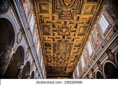 VATICAN - May 2018: Rich ornate corridors of Vatican museums, golden decoration of the ceiling and walls, Vatican, Rome