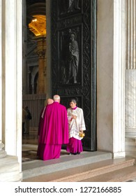 Vatican - Oct 6, 2018: Catholic clergy members in choir dress at the doos of St. Peter's Basilica