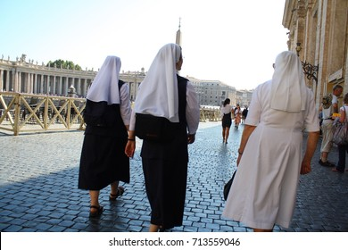 Vatican, Rome, Italy - 08.01.2017: nuns dressed in  black and white, walking in Vatican city, on St Peter's square.
