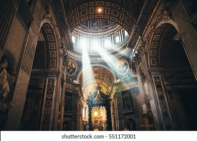 VATICAN, ROME, ITALY - JUNE 4, 2016: Interiors and architectural details of St. Peter Basilica with sun rays in Vatican, Italy