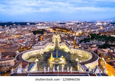 Vatican, Rome, Italy: Night landscape of St Peter's Square and encompassing Rome city as viewed from the dome of St. Peter's basilica, with a Christmas tree decoration next to the obelisk.