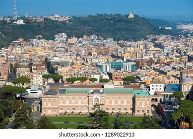 Vatican, Rome, Italy - November 15, 2018 : view of Rome from the height of the dome of St. Peter's Cathedral, in the foreground the building of the Vatican Museum, Vatican City, Rome, Italy