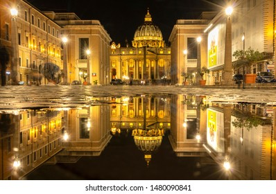 VATICAN, ROME\ITALY - APRIL 30, 2019:Thousands of pilgrims and tourists daily visit the main Shrine of Catholicism - St. Peter's Basilica in the Vatican. Cityscape Vatican at night