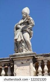 Vatican - Saint Remigius, sculpture in the colonnade of famous Saint Peter's Square. Made by Giovanni Maria de Rossi.