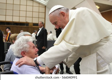 Vatican / Vatican State - 15 August 2015: Pope Francis blesses a woman at a General audience in the Vatican on 15 August 2015