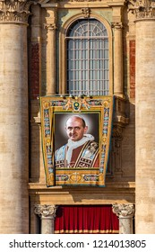 Vatican/Italy - October 14, 2018. St. Peter's Square. Tapestry with the image of Pope Paul VI hanging from a balcony of the facade of St. Peter's Basilica during the canonization mass of seven  saints
