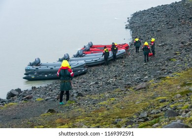 VATNAJOKULL, ICELAND - JULY 28, 201: Two families getting ready to sail on a Blue Ice Zodiac boat tour on the Fjallsarlon Glacial Lagoon on an arm of the huge Vatnajokull glacier in South Iceland