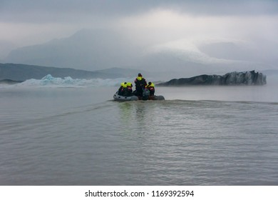 VATNAJOKULL, ICELAND - JULY 28, 201: Two families sailing on a Blue Ice Zodiac boat tour on the Fjallsarlon Glacial Lagoon on an arm of the huge Vatnajokull glacier in South Iceland