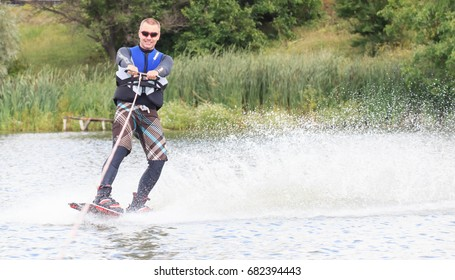 VATUTINE, UKRAINE - JULY 15: The athlete enjoys wakeboarding and coaches tricks on July 15, 2017 in Vatutine, Ukraine