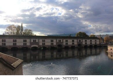 Vauban Dam (or Barrage Vauban) in Strasbourg, France. It was built on River Ill in 17th century and used as a bridge, weir and defensive work.