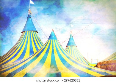 Vaudeville tent tops.  Blue and yellow stripes white flag on top.  Vintage effect with blue sky and white clouds above