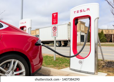 VAUGHAN, CANADA - April 24th, 2019: Close-up of Red Tesla Model S charging at Vaughan Mills Tesla Supercharger location.
