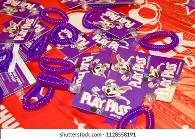 Vaughan, Ontario, Canada - June 4, 2018: Play pass cards in the table in Chucke e Cheese restaurant.