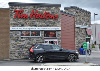 Vaughan, Ontario, Canada - June 5, 2018: Car seen in front of drive thru counter of Tim Hortons.