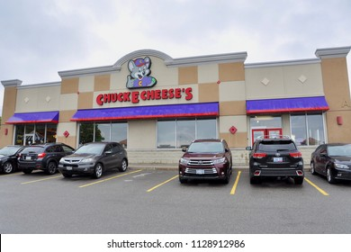Vaughan, Ontario, Canada - June 5, 2018: Cars in front of Chucke E Cheese's restaurant.
