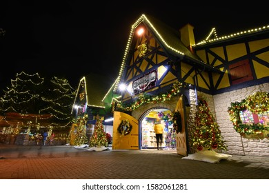 Vaughan, Ontario, Canada - November 29, 2019 - Canada's Wonderland Winterfest Stocking Stuffers building with white lights, red ornaments and trees and garlands.