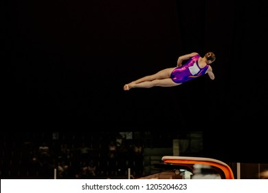 vault attempting female gymnast in gymnastics on black background