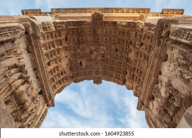 The vault and side panels of the arch of Titus, is a triumphal arch with a single arch, located on the northern slopes of the Palatine Hill, in the eastern part of the Forum of Rome. Italy, Europe