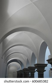 Vaulted / arched ceiling. Tilt close-up photo of modern architecture fragment in neo-Gothic style.