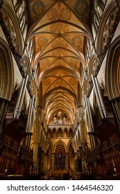 Vaulted ceiling at the Choir and front altar of medieval Salisbury Cathedral with organ pipes Salisbury, England - June 10, 2019